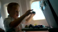 Child playing with toys during the flight video