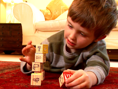 Child plays with coloured bricks video