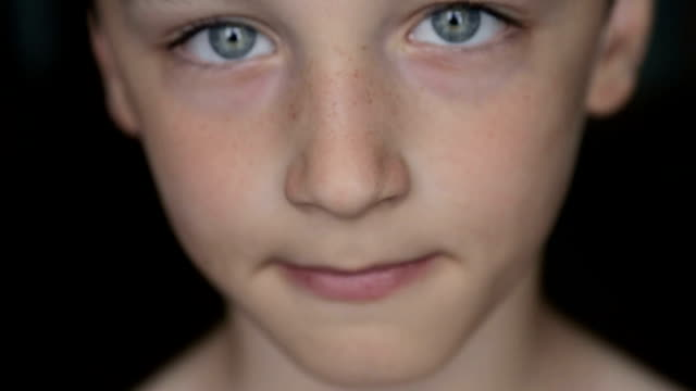 Child portrait, boy looks at the camera video