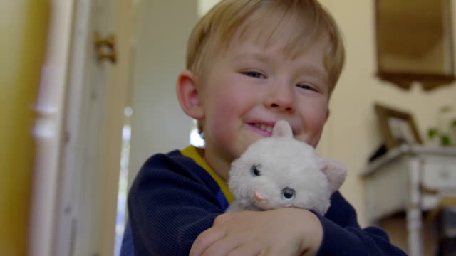 Child poses with toy cat video