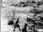 Child pushes a tree--From 1930's film video