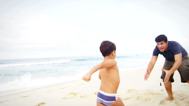 Child runs to his father on a beach video