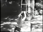 Child swings around a tree-From 1930's film video