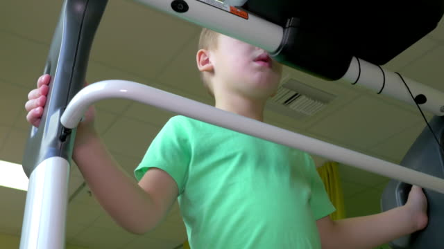 Child undergoing functional electrical stimulation video