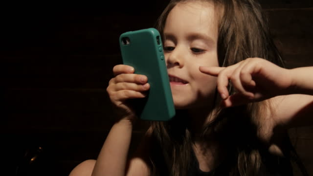 Child Using Smartphone Bedtime video