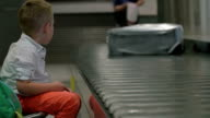 Child waiting at the baggage claim area video