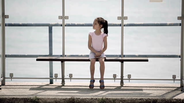 Child waiting for bus video