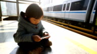 Child Waiting for Train on Platform video