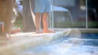 Child walking by the poolside video