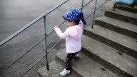 Child walking down stairs video