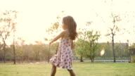 Child walking in the garden video