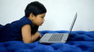 Child watching laptop for entertainment. video