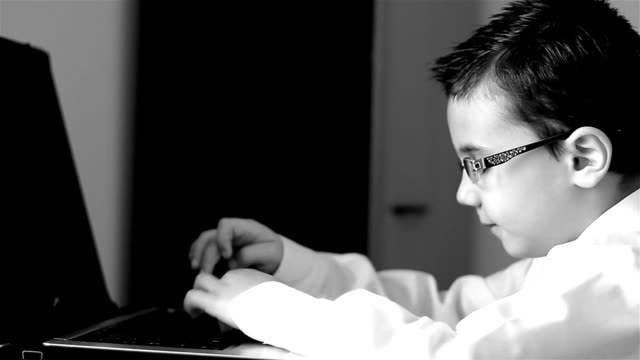 Child with glasses at the computer video
