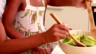 Child with her mother cooking video