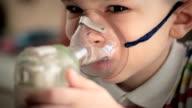 Child with inhaler 1 video