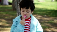 Child with lollipop video