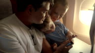 Child with parents traveling by plane video