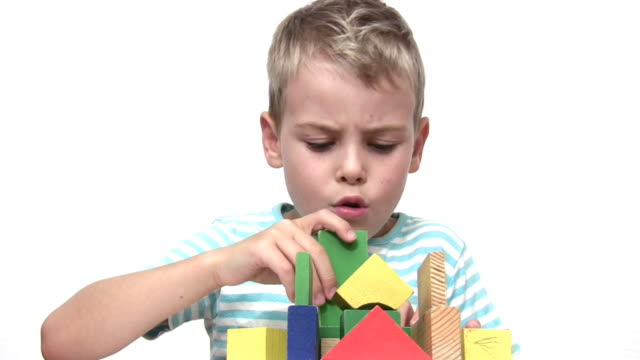 Child with wood toy cubes video