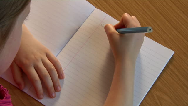 Child writing a story video