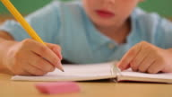 Child writing at school video