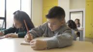 Children at school working in their notebooks video