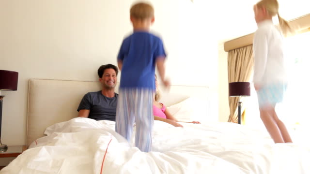 Children Bouncing On Parents Bed video