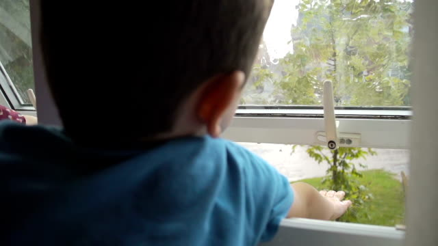 Children Catching Raindrops In A Thunderstorm video
