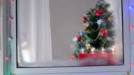 Children celebrating Christmas near decorated tree at home video