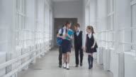Children Chatting in School Hallway video