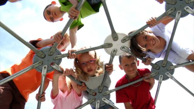 Children climbing on play equipment video