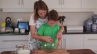 4K Children cracking an egg into bowl video