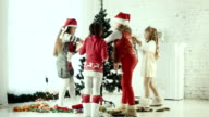 Children decorate the Christmas tree video