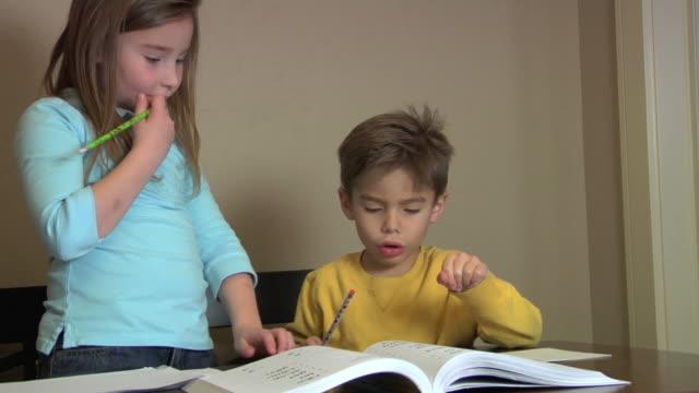 Children doing homework video