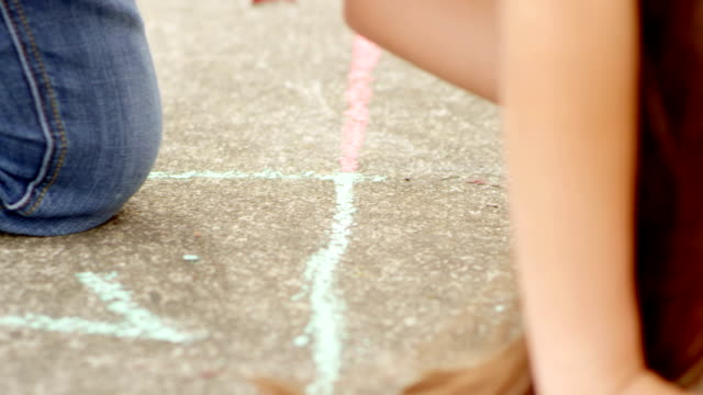 Children Drawing Hopscotch Squares video