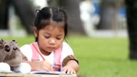 Children drawing in park video