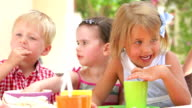 Children Enjoying Food At Party video