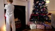 Children hanging their Christmas stockings video