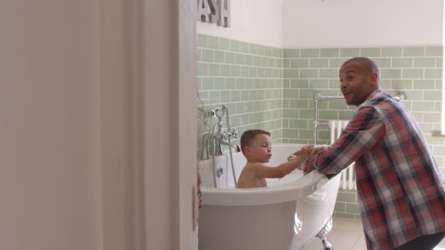 Children Having Bath And Brushing Teeth In Bathroom video