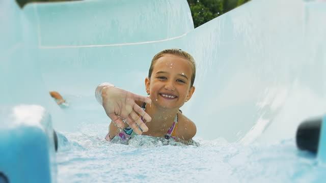 HD SLOW MOTION: Children Having Fun On Water Slide video