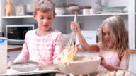 Children Having Messy Fun Baking In Kitchen video