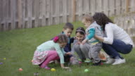 Children huddled around a bunny video