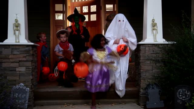 Children in Halloween costumes video
