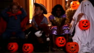 Children in Halloween costumes video