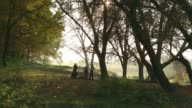 children in the autumn forest video