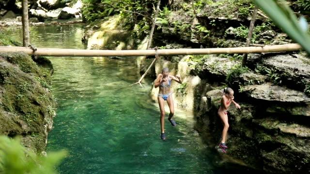 Children jump into water video