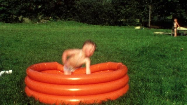 Children jumping in pool (vintage 8mm film) video