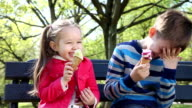 Children licking an ice cream cone video