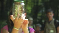 Children looking at insect in jar video