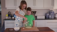 4K Children mixing ingredients for chocolate cake video