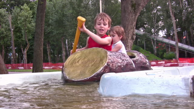 Children on attraction boat video
